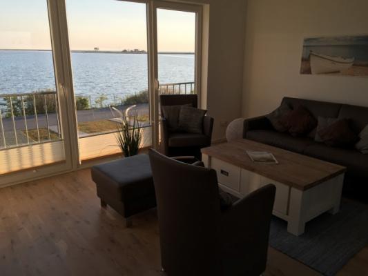 Olpenitz Maisonette Ferienwohnung Sitzen mit Abendsonne