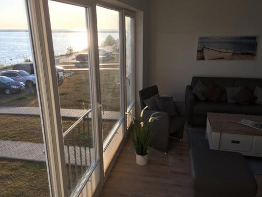 Olpenitz Maisonette Ferienwohnung Wohnzimmer mit Terrasse