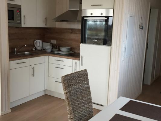 Ferienhaus Olpenitz mit 2 Zimmern kochen