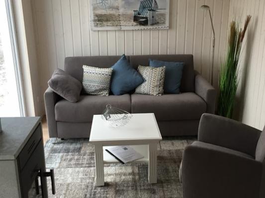 Ferienhaus Olpenitz mit 2 Zimmern Couch