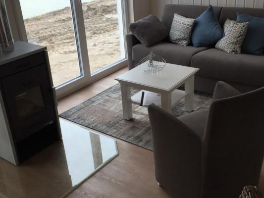 Ferienhaus Olpenitz mit 2 Zimmern Sitzen am Fenster