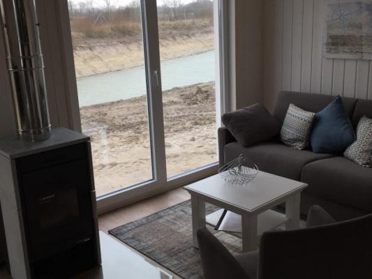 Ferienhaus Olpenitz mit 2 Zimmern sofa mit Fenster
