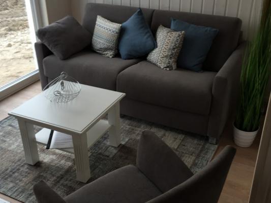 Ferienhaus Olpenitz mit 2 Zimmern Tisch mit Sof